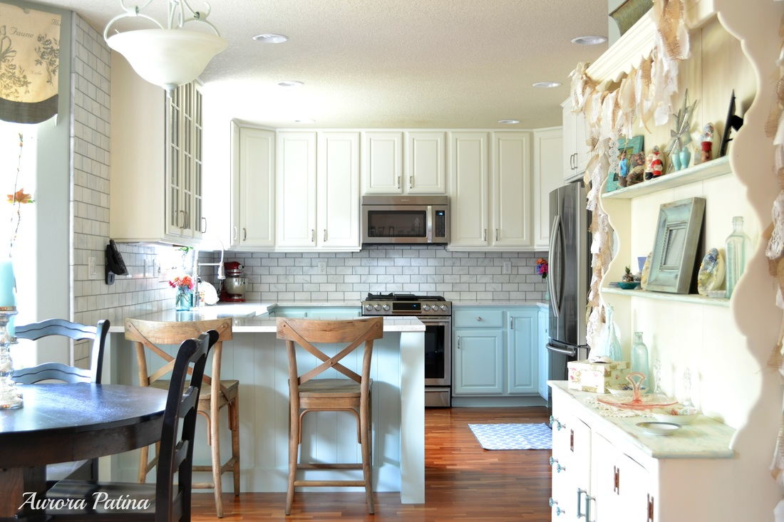 kitchen makeover from dark wood to white and light